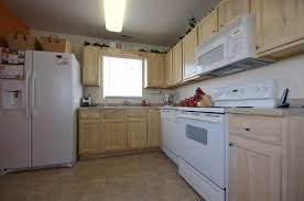 white wood kitchen cabinets wood grained to match white oak