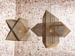 the angles pendant lamp is perfect harmony of laser cut wooden rectangles