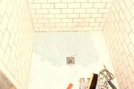 tiling a shower floor or wall first tiling a shower floor or wall first the grit and polish hexagon tile shower floor re do tile shower wall meets floor do