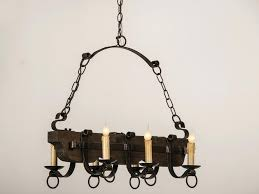black iron candle chandelier old and vintage wood with holder hanging chains for rustic dining room or kitchen lighting ideas fur