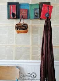 hometalk repurposed books into unique coat rack