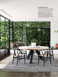 wishbone chair iconic furniture crafted in denmark for dining room wonderful floor to ceiling windows with wishbone chair and round dining table also area