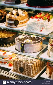 Various Different Types Of Sweet Cakes In Pastry Shop Glass Display