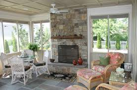 outdoor ceiling fans provide both lighting and air movement on a screen porch