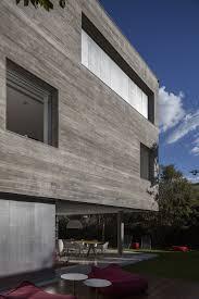 Funky Modern Exterior Walls Design With Wide Wooden Garage Door - Exterior walls