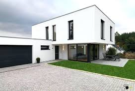 awesome minimalist modern private house with black garage door and glass sliding design along doors uk