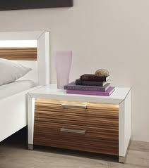 bed side furniture. white modern bedside table with 2 wooden drawers along big glass and some books bed side furniture
