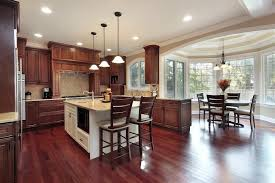 kitchen ideas cherry cabinets. Cherry Wood Flooring And Natural Toned Cabinetry Warm Up This Kitchen, Featuring Attached Dining Kitchen Ideas Cabinets A