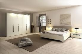 image of bedroom design white cabinets unique lamp wood flooring white wall wooden door