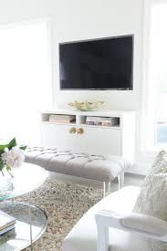 Lucite Floating Shelves Inspiration Amazing TV Room Features A A Gray Tufted Bench On Lucite Legs Is