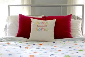 bed embroidered home sweet home throw pillow