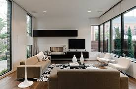 Modern minimalist living room in pristine white. by Lignum Elite. View in  gallery Smart combination of white decor with floating black shelves