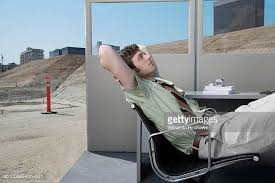 side view office set. men reclining in office set up on construction site side view