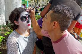 photo essay the day of the dead in oaxaca road affair girl painting her face for the day of the dead celebration in oaxaca