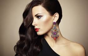 portrait of beautiful brunette woman in black dress makeup hair clothing tips to look
