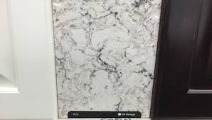 would like any input on using this lg aria quartz countertop with our maple canvas kraftmaid cabinets with a cherry peppercorn island thoughts