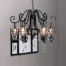 wrought iron and crystal chandelier lighting country french
