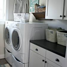 best smart small laundry room decor ideas interior organization interior design white cabinet black countertop modern bright modern laundry room