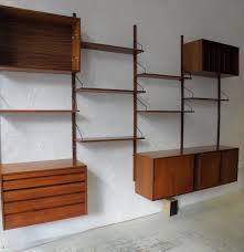 wooden bookcase furniture storage shelves shelving unit. Floating Brown Wooden Shelves With Black Handler Plus Storage  Connected Pole. Fascinating Wall Mounted Shelf Units Wooden Bookcase Furniture Storage Shelves Shelving Unit L