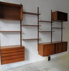 floating brown wooden shelves with black handler plus brown wooden storage connected with brown wooden pole fascinating wall mounted shelf units