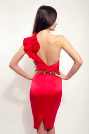 Girl Posing Fashion In Sexy Red Dress With Naked Back And Tight On The Butt Beautiful Brunette Woman Wearing A One Sleeve Red Dress And Holding Her Hand On Her Waist