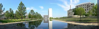 oklahoma city bombing a panoramic view of the memorial in the center is a large stone structure shaped