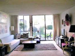area rug on carpet living rooms with rugs on carpets apartment ideas living room rugs on