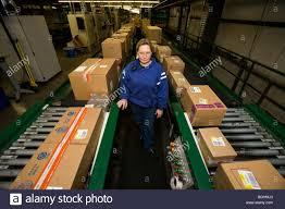 mart cart stock photos mart cart stock images alamy a walmart stores inc associate keeps watch over a conveyor line at a distribution center