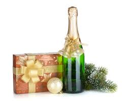 Image: Champagne bottle, christmas gift box, decor and fir tree