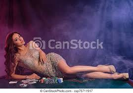 Girl in golden dress playing poker at casino, laying on table with chips,  money, cards on it. black, smoke background. | CanStock