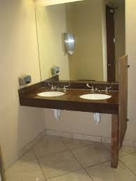 wheelchair accessible bathroom sinks. A Commercial ADA Vanity With Granite Top Equiped Blade Handle Controlled Faucet And Undermount Sink Showing Insulated Plumbing In Restroom Wheelchair Accessible Bathroom Sinks