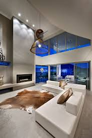 baroque animal skin rugs in living room contemporary with white couch next to gas fireplace alongside