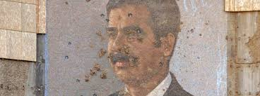 stable dictatorships are not the lesser evil online a bullet riddled portrait of saddam hussein in baghdad in 2003