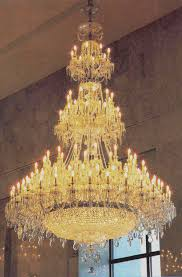 49 w x 47 h 12 8 6 lights 3289 60 w x 53 h 16 12 8 lights 5179 dramatic styling in solid brass with glass columns and glass bobeches