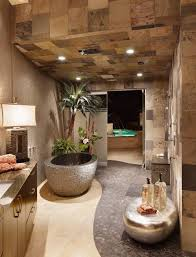 Home spa design with stone bathtub and outdoor water fountain