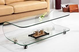 Ultra modern living room with curved modern glass coffee table on wheels  near modern sofa
