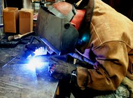 Free Public Domain Image Military Metal Worker Welding A Handle