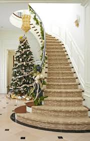Love this elegant holiday staircase! A seeded glass ball tops the newel  post for a