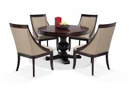 gatsby round 5 piece dining set with swoop chairs dining room sets dining room bob s furniture