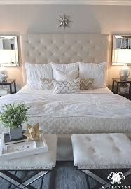 Best 25+ Quilted headboard ideas on Pinterest | Bed goals, Cozy ... & Kelley Nan: Master Bedroom Update- Calming White and neutral master bedroom  with tufted ottoman Adamdwight.com