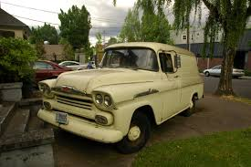 OLD PARKED CARS.: 1958 Chevy Suburban.