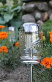 cool mason jar outdoor lighting dollar solar powered yard stake in a mason jar plastic