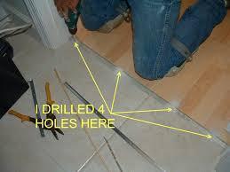 installing floor tile on concrete here i drill 4 holes for the laminate transition track installing porcelain tile over concrete floor installing floor tile