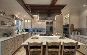 farmhouse kitchen with white marble countertops and off white cabinets