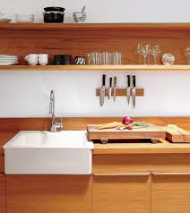 a cutting board sits on the cypress veneer countertop in uusi cofounder peter dunham s kitchen