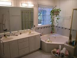 awesome bathroom using white furniture ideas and bathroom lighting fixtures completed with corner bathtub and vanity awesome bathroom lighting bathroom