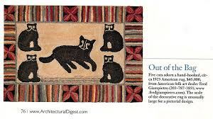 here s a beautiful rug with 5 cats and a colourful border from an old edition of architectural digest