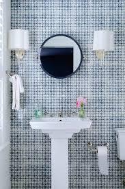 blue bathroom with navy mirror