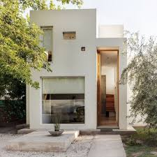Minimalist House // oversized modern statement door - Casa Besares by  Arquinoma via  CONTEMPORIST