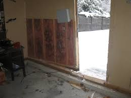 that force buckled the door and damaged the door jamb frame the gray box on the wall and wire coming out of the lower section of the wall is the lawn